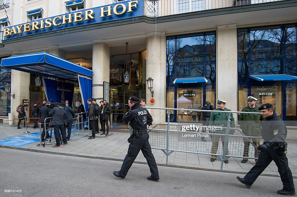 Policemen carry a barrier in front of the hotel Bayerischer Hof ahead of the 2016 Munich Security Conference at the Bayerischer Hof hotel on February 12, 2016 in Munich, Germany. The annual event brings together government representatives and security experts from across the globe and this year the conflict in Syria will be the main issue under discussion.