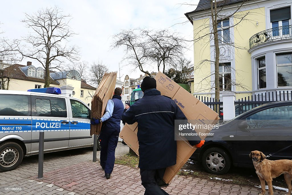 Policemen carry boxes out of the headquarters of the S&K investment group the day after police raided the company's offices on February 20, 2013 in Frankfurt, Germany. Police made six arrests across Germany and state prosecutors are charging that the company has swindled investors out of investments totaling over one hundred million Euros. At least one of the company's founders, Jonas Koeller and Stephan Schaefer, was among those arrested yesterday.
