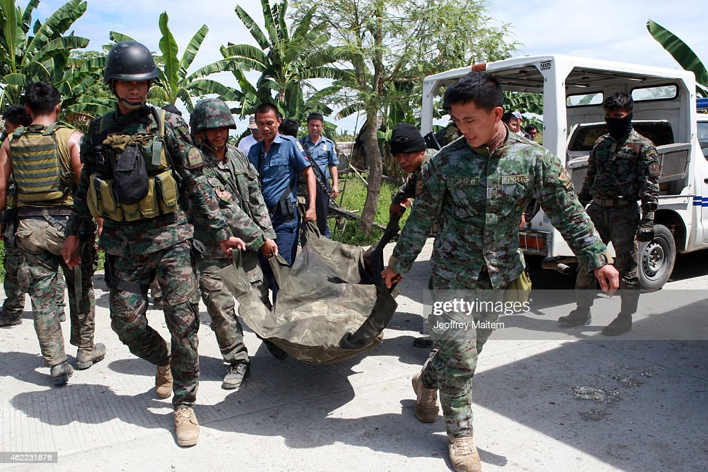 Policemen carry the body of their comrade during a retrieval operation on January 26, 2015 in Mamasapano, Maguindanao Province, Philippines. Dozens of elite policemen were killed after a clash with a Muslim rebel group. Lawmen would suppose serve the arrest warrants on January 25, 2015 for criminals led by Malaysian bomb maker Zulkifli bin Hir, known in military and police officials as Marwan, when the group clashed with the guerillas under Commander Guiawan of Bangsamoro Islamic Freedom Fighters, a breakaway group of the Moro Islamic Liberation, the countrys largest rebel group engaged in peace talks with Manila. The death toll of government fatalities in the fierce firefight reached fifty.