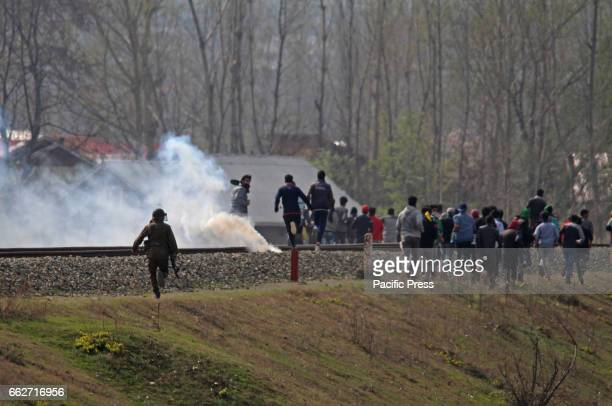 Policemen chasing stone pelter during the clashes in the outskirts of Srinagar in Indian Controlled Kashmir on Mar 31 2017 The protests and clashes...