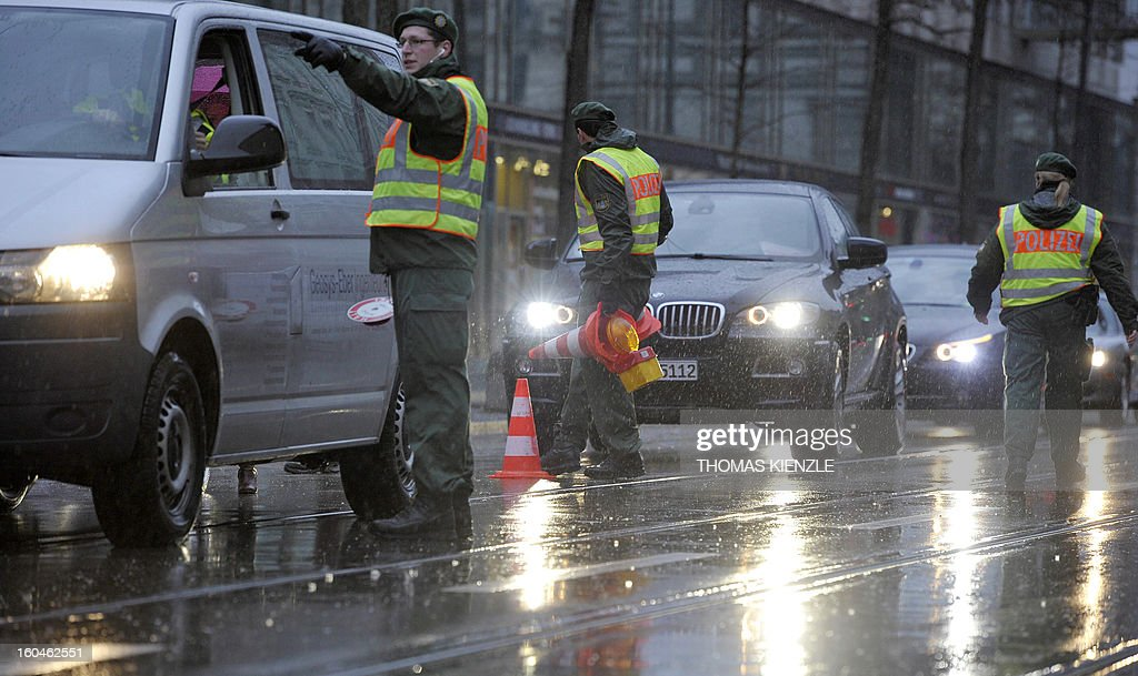 Policemen check cars in front of the Bayerischer Hof hotel in Munich, southern Germany, on February 1, 2013, where the 49th Munich Security Conference will start in the afternoon