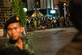 Policemen check the scene of an explosion on August 17 2015 in Bangkok Thailand A large explosion believed to be from a bomb has happened in central...
