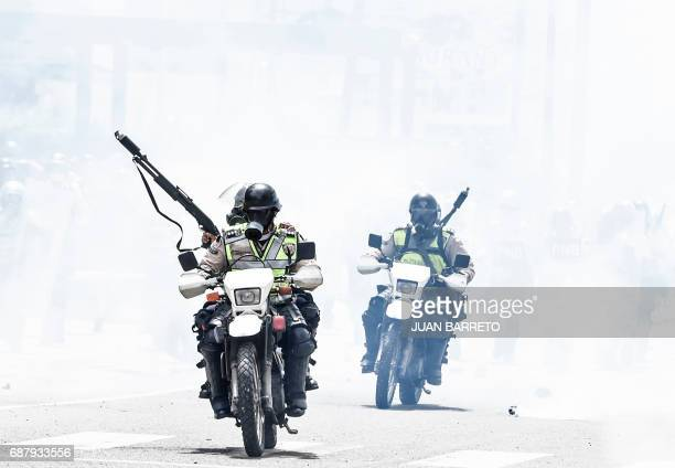 TOPSHOT Policemen clash with opposition demonstrators in Caracas on May 24 2017 Venezuela's President Nicolas Maduro formally launched moves to...