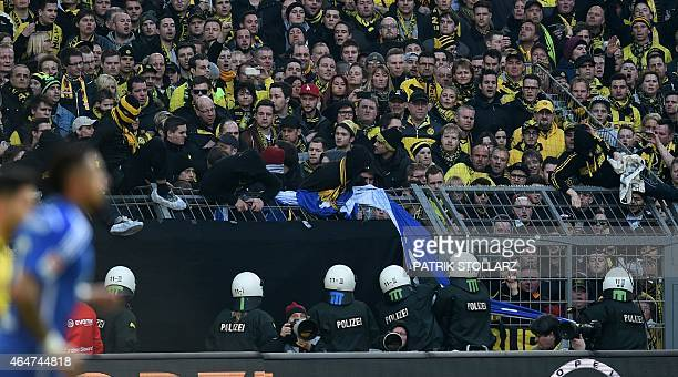 Policemen confiscate a banner from Dortmund fans during the German first division Bundesliga football match Borussia Dortmund vs FC Schalke 04 in...
