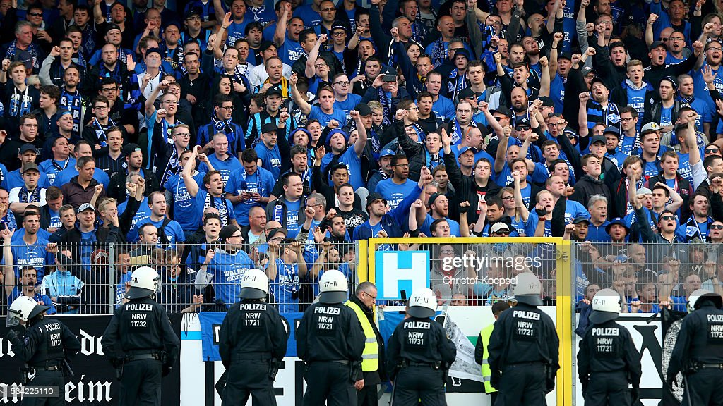 Policemen control the fans of Mannheim during the Third League play-off first leg match between SF Lotte and Waldhof Mannheim at Sportpark am Lotter Kreuz on May 25, 2016 in Lotte, Germany.