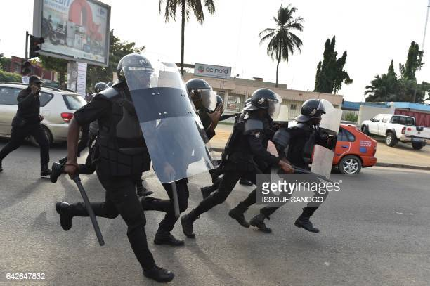 Policemen disperse protesters angry subscribers who invested in agribusiness companies during a demonstration on February 18 2017 in Abidjan after...