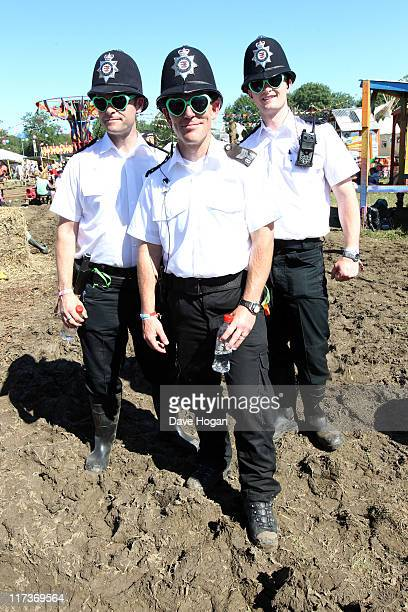 Policemen enjoy the warm weather at the Glastonbury Festival at Worthy Farm Pilton on June 26 2011 in Glastonbury England The festival which started...
