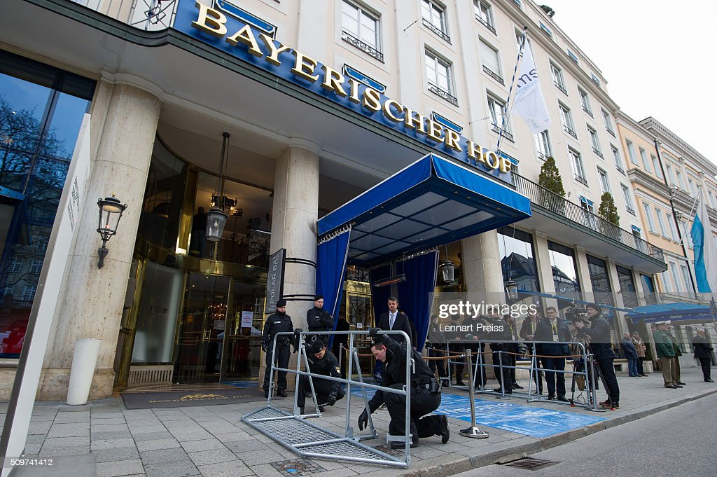 Policemen erect a barrier in front of the hotel Bayerischer Hof ahead of the 2016 Munich Security Conference at the Bayerischer Hof hotel on February 12, 2016 in Munich, Germany. The annual event brings together government representatives and security experts from across the globe and this year the conflict in Syria will be the main issue under discussion.