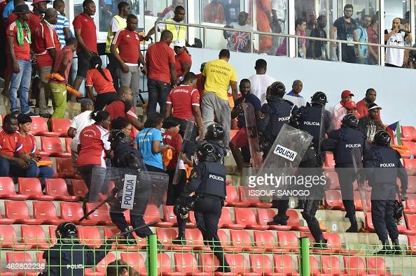 Policemen evacuate a tribune during the 2015 African Cup of Nations semifinal football match between Equatorial Guinea and Ghana in Malabo on...