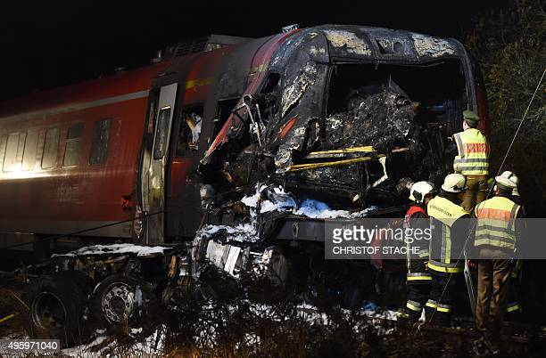 Policemen examine the destroyed cockpit of a regional train after it collided with a lorry at a crossing near the village Freihung southern Germany...