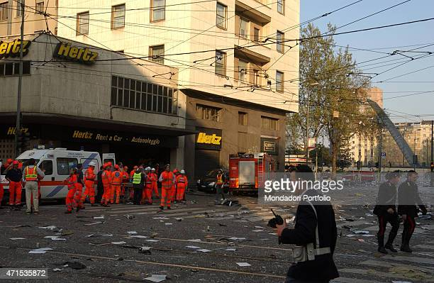 'Policemen firefighters and paramedics involved on the scene of a tragic accident at the Pirelli Tower a light aircraft crashed into the building...