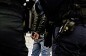 Policemen from a brigade in charge of Paris transport network arrest a man who allegedly robbed a sleepy traveller in a Paris subway station on April...