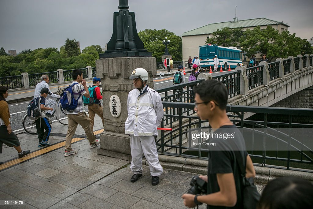 Policemen from Nagasaki stand guard and control traffic at one of the entry check points in Peace Memorial Park on May 26, 2016 in Hiroshima, Japan. On May 27, 2016, the U.S. President Obama is scheduled to visit Hiroshima, which will be the first time a U.S. President makes an official visit to the iconic site where the atomic bomb was dropped in the end of World War II.