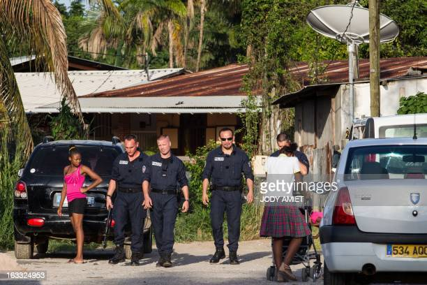 Policemen from the anticrime unit patrol in Cayenne's Mango neighborhood on March 7 2013 during a three days visit by France's Interior minister in...