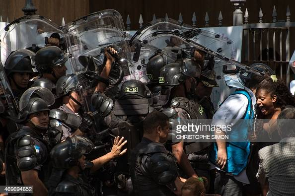 Policemen from the special unit CHOQUE enter the occupied building to push out squatters in Flamengo Rio de Janeiro on April 14 2015 More than 100...