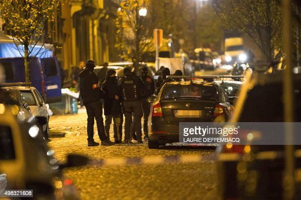 Policemen gather during an intervention in Brussels on November 22 2015 Brussels will remain at the highest possible alert level with schools and...