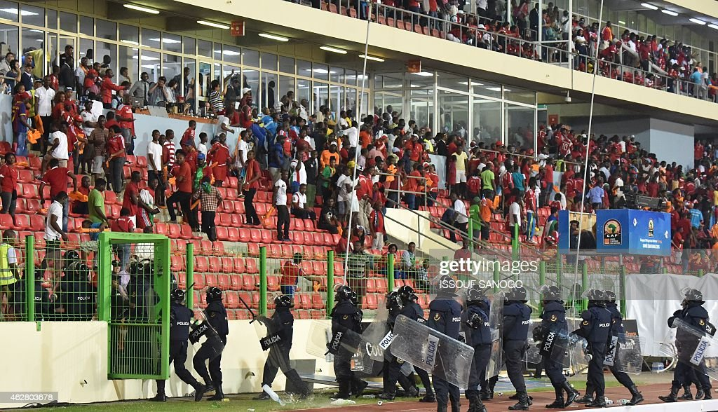 Policemen get ready to evacuate a tribune during the 2015 African Cup of Nations semifinal football match between Equatorial Guinea and Ghana in...