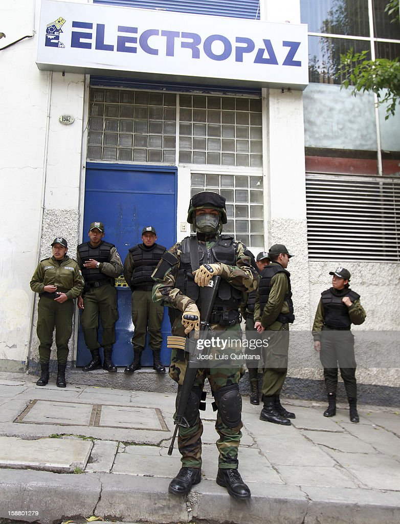 Policemen guard a Bolivian sub power station during the nationalization of Electropaz on December 29, 2012 in La Paz, Bolivia.