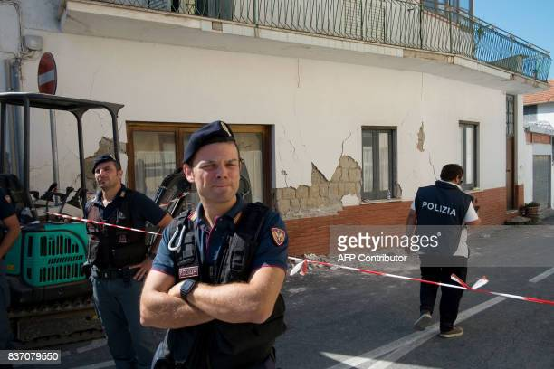 Policemen guard a cordoned off zone in Casamicciola Terme on the Italian island of Ischia on August 22 after an earthquake hit the popular Italian...