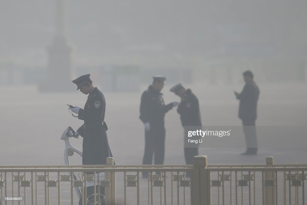 Policemen guard at the Tiananmen Square as delegates attending a plenary session of the Chinese People's Political Consultative Conference during severe pollution on March 8, 2013 in Beijing, China. Clearing urban air pollution has become a big concern during the Chinese People's Political Consultative Conference.