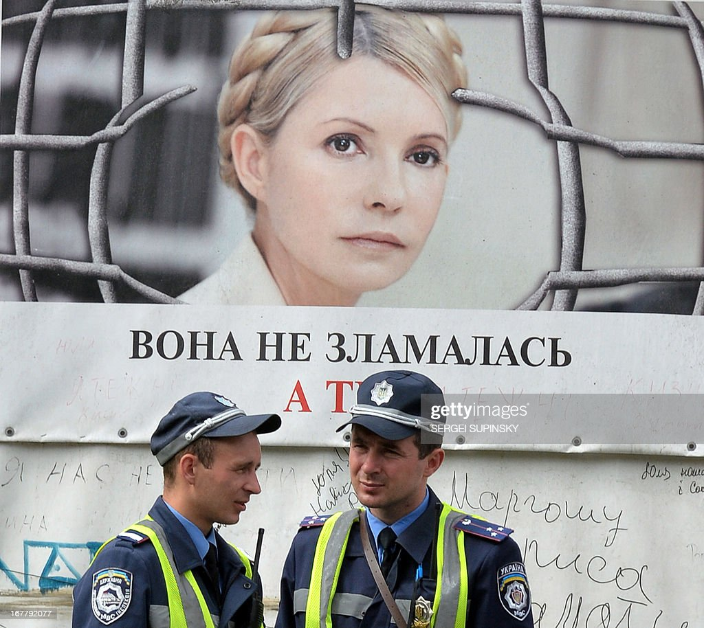 Policemen guard in front of a placard depicting jailed former Ukrainian prime minister and the leader of the opposition, Yulia Tymoshenko, reading 'She is not broken. What about You?' in the center of Kiev on April 30, 2013. The European Court of Human Rights on April 30 ruled that Ukraine's detention of Yulia Tymoshenko was unlawful but threw out accusations of ill-treatment. 'The Court considered that the detention had been arbitrary and unlawful during the entire period,' the judges of the Strasbourg-based court said.