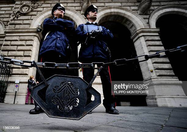 Policemen guard in front of the Bank of Italy in Rome where a conference in honour of the late economist Tommaso PadoaSchioppa takes place on...