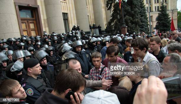 Policemen guard outside regional city building as proRussian protesters qttend attend a rally to mark the May Day in northeastern Ukrainian city of...