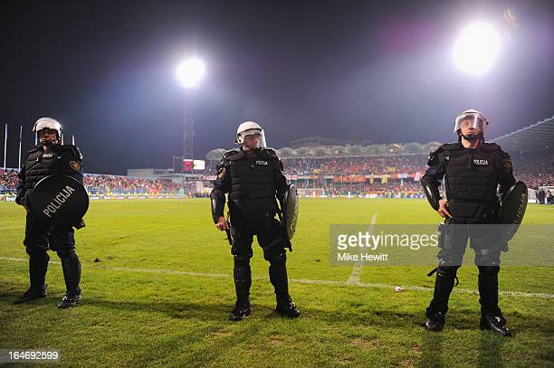 Policemen guard the pitch during the FIFA 2014 World Cup Qualifier Group H match between Montenegro and England at City Stadium on March 26 2013 in...