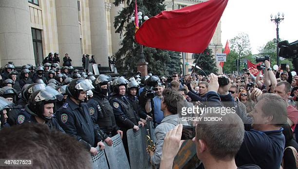 Policemen guard the regional city building during a rally of proRussian protesters to mark the May Day in northeastern Ukrainian city of Kharkiv on...