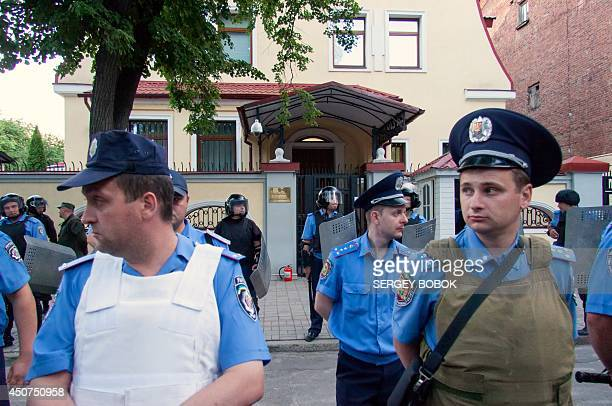 Policemen guard the Russian consulate in the northeastern Ukrainian city of Kharkiv within a protest against Russia's president on June 16 2014 The...