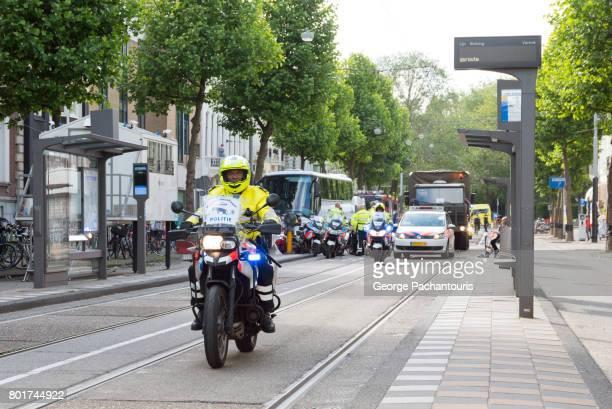 Policemen in motorcycles in Amsterdam, Netherlands