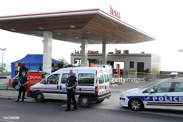 Policemen investigate around a crime scene on October 16 2012 outside a petrol station in French Corsican island's town of Ajaccio after the lawyer...