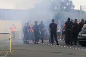 Policemen keep supporters away before the French L1 football match Bastia against Marseille on August 9 2014 at the Armand Cesari stadium in Bastia...
