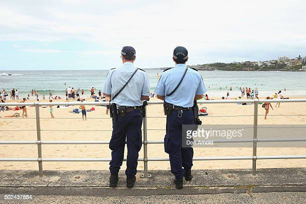 Policemen keep watch at Bondi Beach on December 25 2015 in Sydney Australia Bondi Beach is a popular tourist destination on Christmas Day