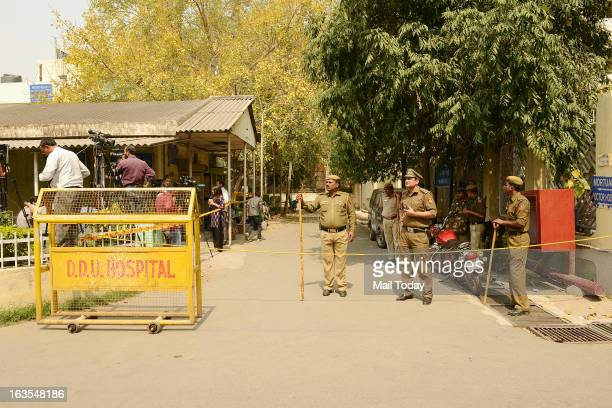 Policemen keep watch outside the Deen Dayal Upadhyay Hospital mortuary after the main accused of a Delhi gang rape case Ram Singh was found dead in...