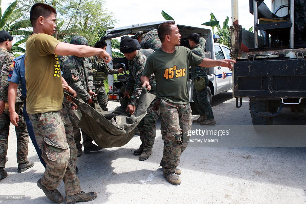 Policemen load into a truck the body of their comrade during a retrieval operation on January 26, 2015 in Mamasapano, Maguindanao Province, Philippines. Dozens of elite policemen were killed after a clash with a Muslim rebel group. Lawmen were trying to serve arrest warrants on January 25, 2015 for criminals led by Malaysian bomb maker Zulkifli bin Hir, known in military and police officials as Marwan, when the group clashed with the guerillas under Commander Guiawan of Bangsamoro Islamic Freedom Fighters, a breakaway group of the Moro Islamic Liberation, the countrys largest rebel group engaged in peace talks with Manila. The death toll of government fatalities in the fierce firefight reached fifty.