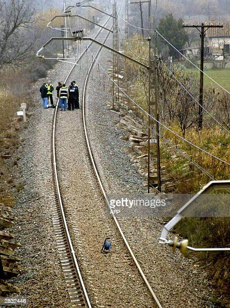 Policemen look at the device placed by ETA in Samper of Calanda's municipal rail 26 December 2003 Two days after thwarting a potentially devastating...