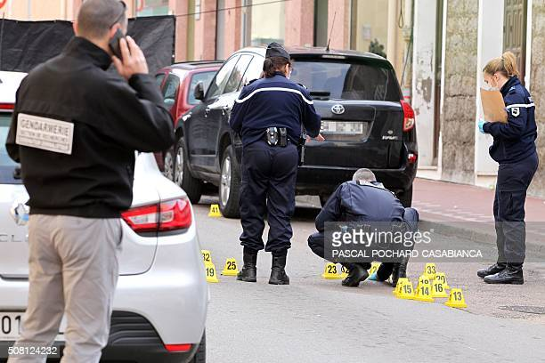 Policemen look for evidence near a Muslim butcher's shop that was sprayed with bullets overnight on February 3 2016 in Propriano on the French...
