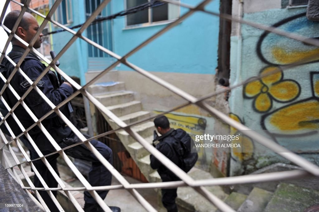 Policemen of the Special Operations Battalion (BOPE) patrol a street at Ilha do Governador neighborhood in the favela do Dende shantytown in Rio de Janeiro, Brazil on January 24, 2013. Drug traffickers clashed with BOPE policemen Thursday early morning. Three people were killed and four were detained during the clashes.