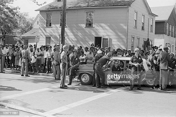 Policemen on duty during a race riot in Rochester New York State late July 1964