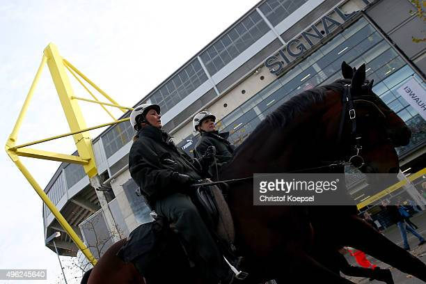 Policemen on horses observe the situation in front of the Signal Iduna Park prior to the Bundesliga match between Borussia Dortmund and FC Schalke 04...