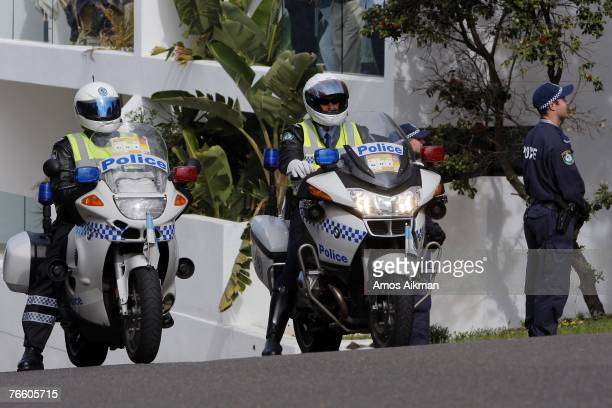 Policemen on motorbikes and on the roadside guard the entrance to Bondi Icebergs location of the APEC spouses' lunch on September 9 2007 in Sydney...