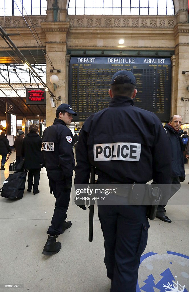 Policemen patrol as part of France's national security alert system 'Plan Vigipirate' which is reinforced for the end of the year celebrations, on December 21, 2012 in front of Gare du Nord railway station in Paris.
