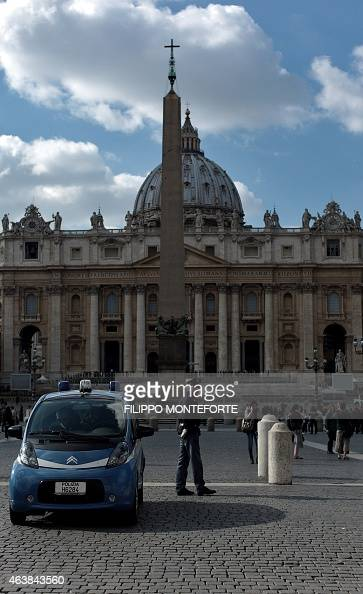 Policemen patrol at St Peter's square on February 19 2015 at the Vatican Security at the Vatican and across Italy has been stepped up because of a...
