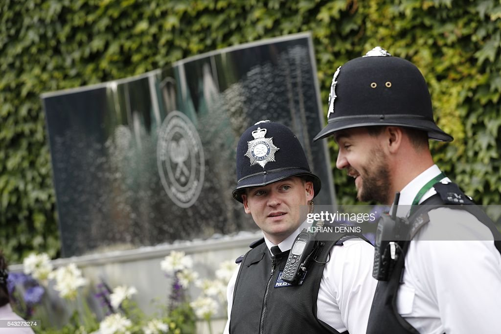 Policemen patrol at The All England Lawn Tennis Club in Wimbledon, southwest London, on June 27, 2016 on the first day of the 2016 Wimbledon Championships. / AFP / ADRIAN