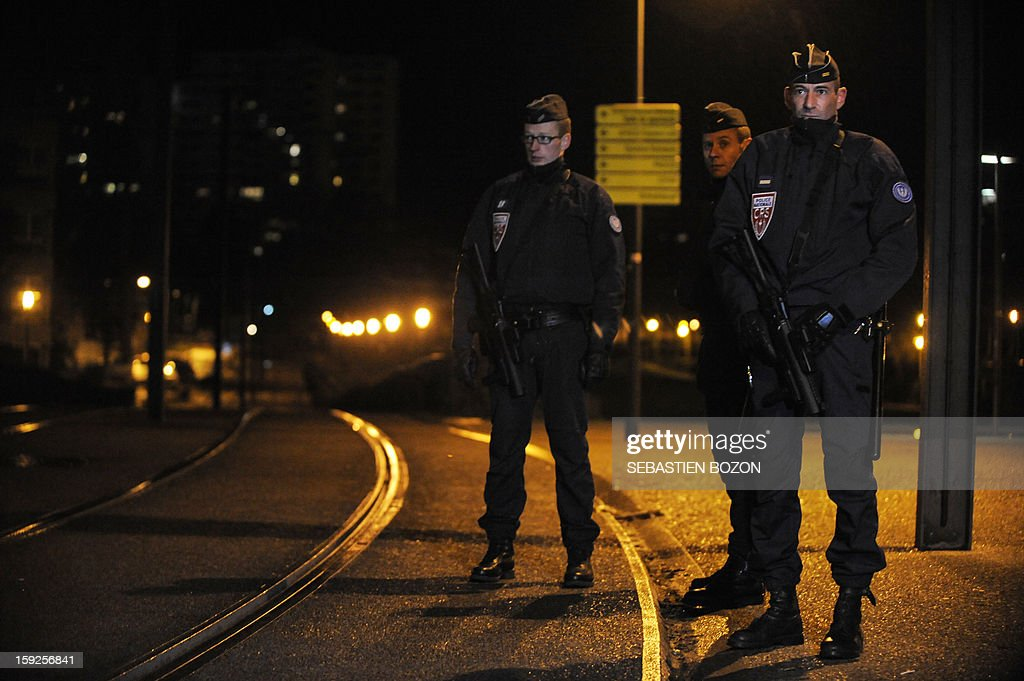 Policemen patrol in Les Coteaux, a district of Mulhouse, on January 10, 2013. The district of 'Les Coteaux ' is one of 49 'Zone de Sécurité Prioritaire' (ZSP) ('Priority Security Zones') where the fight against criminality and violence are a major issue. Many cars were burnt in the district during the new year's celebration on December 31, 2012, and youths threw a few Molotov cocktails at a tramway on January 5, 2013.