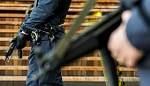 Policemen patrol near the courthouse on Bolivar Square in Antwerp on January 16 the day after an antiterrorist operation Belgian authorities charged...