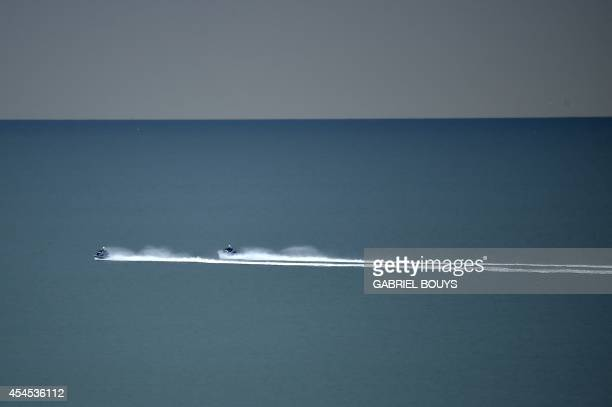 Policemen patrol on jetski in front of the Palazzo del Cinema during the 71st Venice Film Festival on September 2 2014 at Venice Lido AFP PHOTO /...