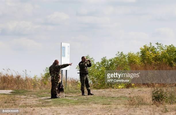 Policemen patrol the border area at Triplex Confinium near Beba Veche western Romania where the borders of Romania Hungary and Serbia meet on...