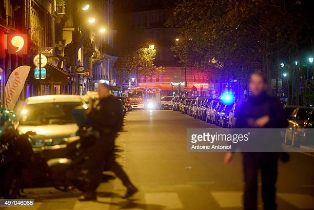 Policemen patrol the streets during gunfire near the Bataclan concert hall on November 13 2015 in Paris France Gunfire and explosions in multiple...